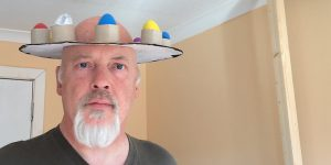 John with shaky egg hat