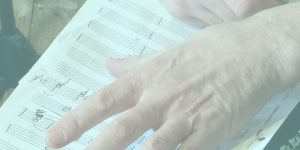 hand on manuscript